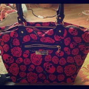 Pink and black skull Betsey Johnson purse.